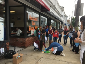 students painting in front of Anita Maries